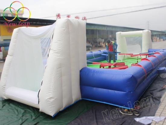 Inflatable human foosball table